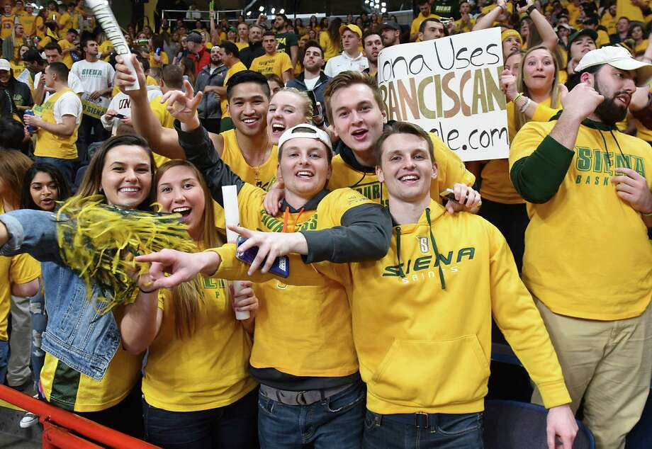 Siena fans cheer during the MAAC men's championship game against Iona at the Times Union Center on Monday, Feb. 6, 2017 in Albany, N.Y.  (Lori Van Buren / Times Union) Photo: Lori Van Buren / 20039808Ao903