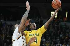 Siena's Kadeem Smithen is guarded by Iona's Taylor Bessick as he drives to the basket during the MAAC men's championship game at the Times Union Center on Monday, Feb. 6, 2017 in Albany, N.Y.  (Lori Van Buren / Times Union)