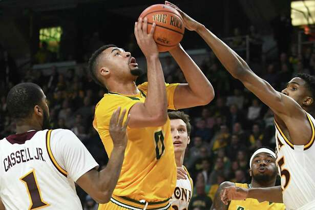 Siena's Javion Ogunyemi is fouled as he drives to the basket during the MAAC men's championship game against Iona at the Times Union Center on Monday, Feb. 6, 2017 in Albany, N.Y.  (Lori Van Buren / Times Union)