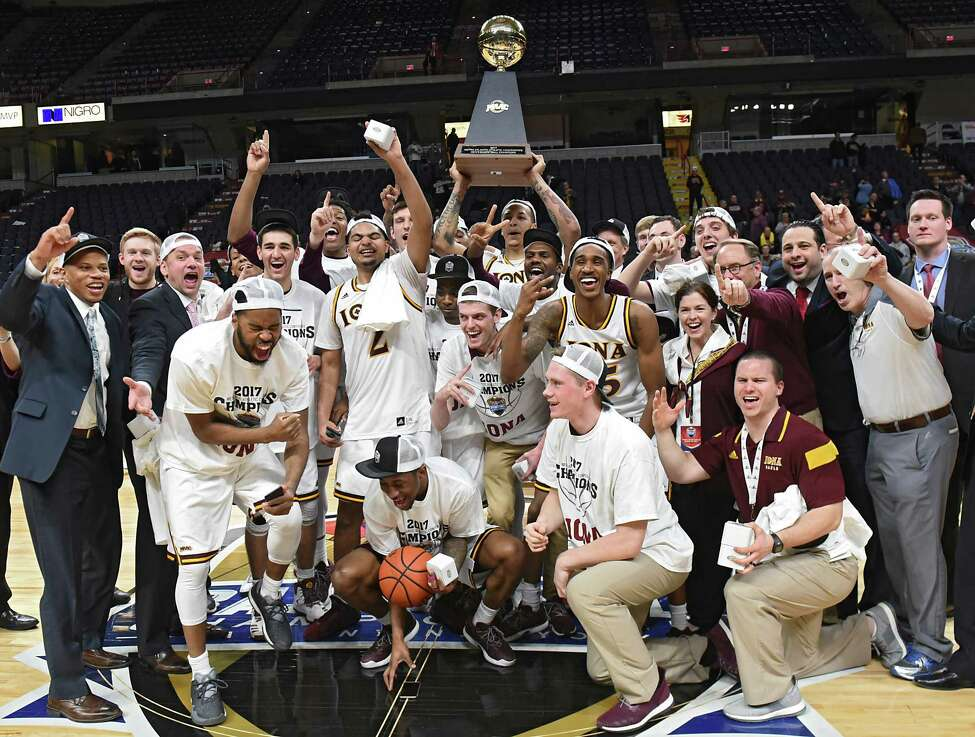 Iona celebrates their victory against Siena in the MAAC men's championship game at the Times Union Center on Monday, Feb. 6, 2017 in Albany, N.Y. (Lori Van Buren / Times Union)