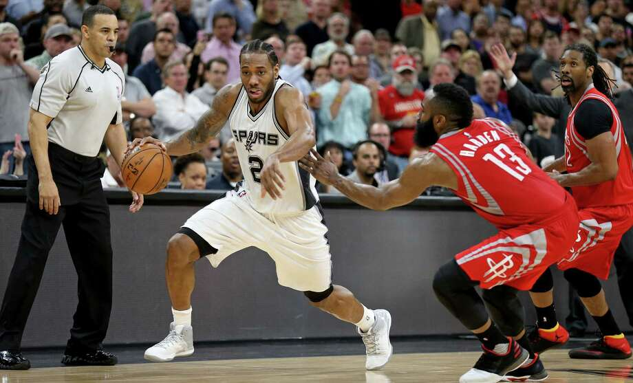 Kawhi Leonard rushes past the Rockets' James Harden on March 6 at the AT&T Center. Photo: Edward A. Ornelas /San Antonio Express-News / © 2017 San Antonio Express-News
