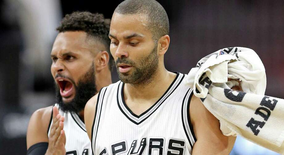 Spurs' Patty Mills celebrates with teammate Tony Parker during a second half timeout against the Houston Rockets on March 6, 2017 at the AT&T Center. The Spurs won 112-110. Photo: Edward A. Ornelas /San Antonio Express-News / © 2017 San Antonio Express-News