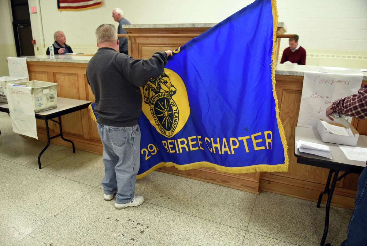 Ed Oleski, president of the Teamsters Local 294 retirees, rolls up a Teamsters banner following a meeting about a proposed 31% cut to their pension plan on Monday, March, 6, 2017, at the Labor Temple in Albany, N.Y. (Will Waldron/Times Union)