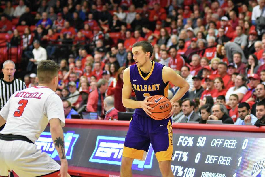 UAlbany's Joe Cremo looks for a path to the basket against Stony Brook on Monday. (Jim Harrison / Special to the Times Union) Photo: Jim Harrison / JDMBLI Digital Pu / 2017  |  Stony Brook Athletics  |  Jim Harrison