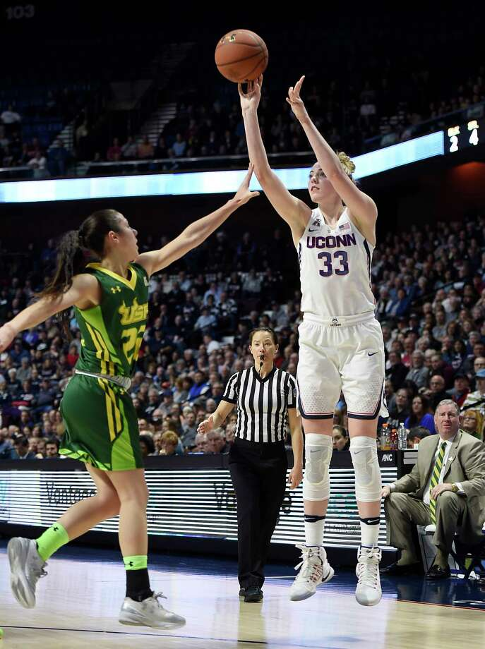 Connecticut's Katie Lou Samuelson shoots over South Florida's Laia Flores, left, during the first half of an NCAA college basketball game in the American Athletic Conference tournament finals at Mohegan Sun Arena, Monday, March 6, 2017, in Uncasville, Conn. (AP Photo/Jessica Hill) Photo: Jessica Hill, FRE / AP2017