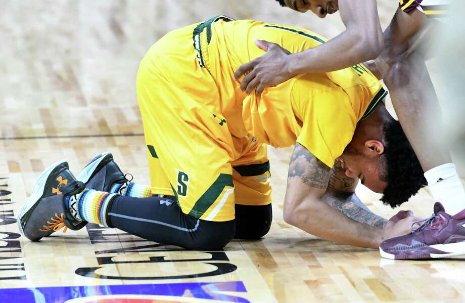 Siena's Marquis Wright breaks down after sinking a three pointer at the buzzer with his team coming up short one point as they lose the MAAC men's championship game against Iona at the Times Union Center on Monday, Feb. 6, 2017 in Albany, N.Y.  (Lori Van Buren / Times Union) Photo: Lori Van Buren / 20039808Ao903