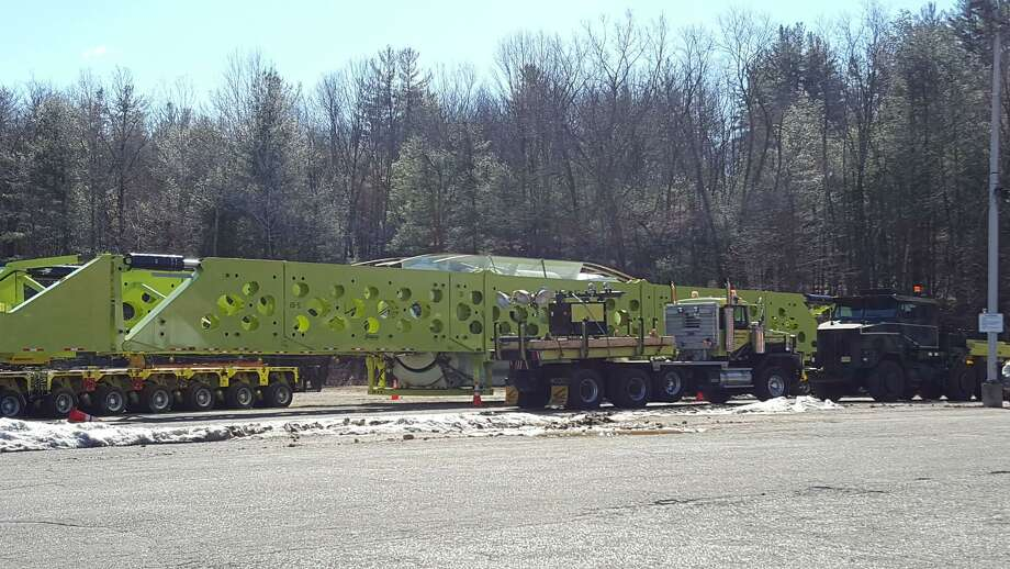 In this image from the town of Barkhamsted's Facebook page, a large piece of equipment slated for the power plant under construction in Oxford waits by the side of the road along its journey from Windsor Locks. Photo: Contributed Photo