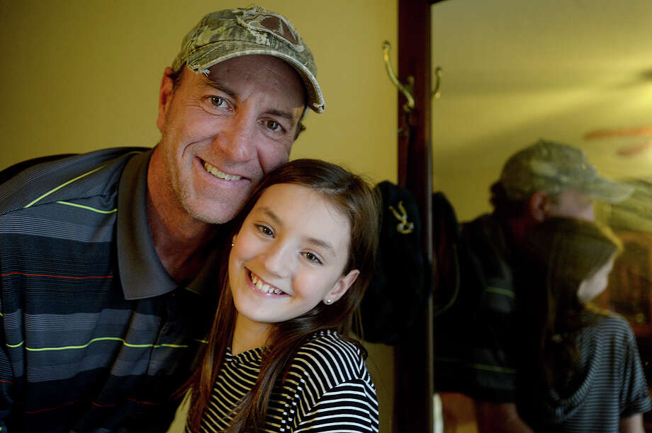 "Twelve-year-old Sadie has heard choruses of the phrase ""you have the coolest Dad"" from classmates and teachers alike this week after a video showing she and father Ray Mason dancing at the Caldwood Elementary School father-daughter dance went viral. The pair were caught on camera as they danced to Bruno Mars' ""24K Magic,"" and Mason says he was inundated with calls the next day from friends who saw the post on Facebook and noticed the over 3 million views it had gotten.  Photo taken Monday, March 6, 2017 Kim Brent/The Enterprise Photo: Kim Brent / BEN"