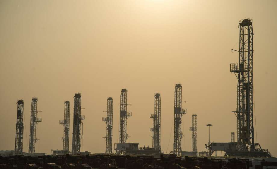Drilling rigs stacked in a yard in Odessa are partially obscured by smoke Tuesday 03-07-17 morning from a large grass fire near Amarillo. Tim Fischer/Reporter-Telegram Photo: Tim Fischer/Midland Reporter-Telegram