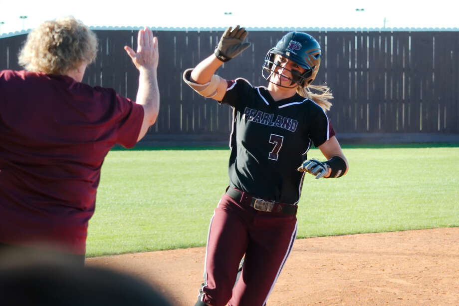 Pearland's Ashlyn Walls (7) gets a high five from Pearland softball coach Laneigh Clark after hitting a home run against Corpus Christi Carroll Thursday, Feb. 23 at Pearland High School. Photo: Kirk Sides / © 2017 Kirk Sides / Houston Chronicle