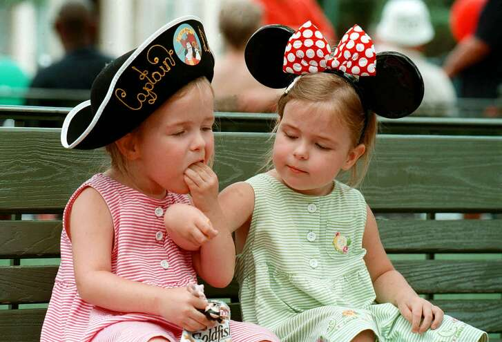 Young guests take a food break in the Magic Kingdom at Walt Disney World Resort in Lake Buena Vista, Fla., in this undated photo. A travel expert advises planning trips around your own child's temperament and attention span.