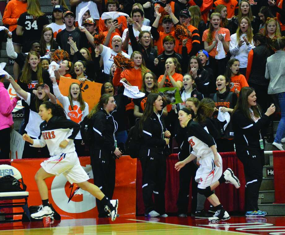 Edwardsville enters from the tunnel in front of the student section. Photo: Matthew Kamp • Intelligencer