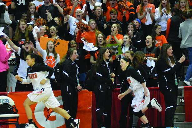 Edwardsville enters from the tunnel in front of the student section.