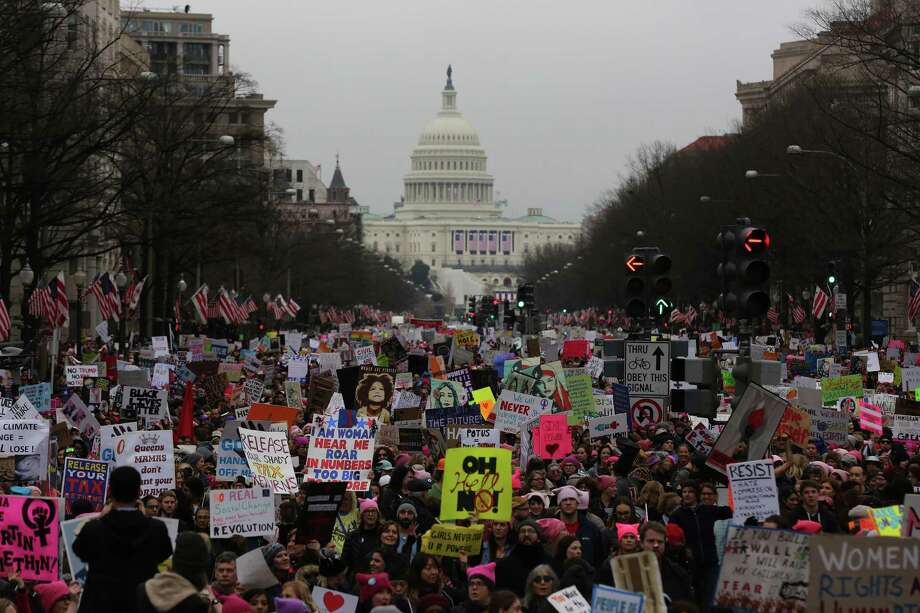 """Tens of thousands march to the White House down Pennsylvania Avenue during the Women's March on Washington on Jan. 21. The march's organizers are calling for female workers to stay home on Wednesday for """"A Day Without a Woman,"""" a national day of protest intended to call attention to the critical role women play in the labor force. Photo: Evelyn Hockstein /For The Washington Post / For The Washington Post"""