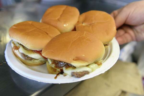 A plate of sliders is served to customers as Jack's Drive In opens for its 79th season Tuesday March 7, 2017 in Wynantskill, NY.  (John Carl D'Annibale / Times Union)