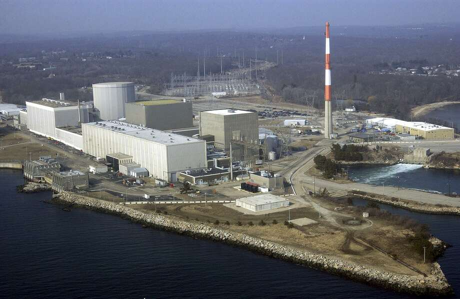 FILE - This March 18, 2003 aerial file photo shows the Millstone nuclear power facility in Waterford, Conn. The impending retirement of Massachusetts' only nuclear power plant could roil energy markets across New England, leading to greater reliance on natural gas, driving up carbon emissions and putting more pressure on pipelines already facing bottlenecks. Pilgrim Nuclear Power Station, the only nuclear power plant in Massachusetts, recently announced it will close by June 2019. (AP Photo/Steve Miller, File) Photo: Steve Miller / Associated Press / AP