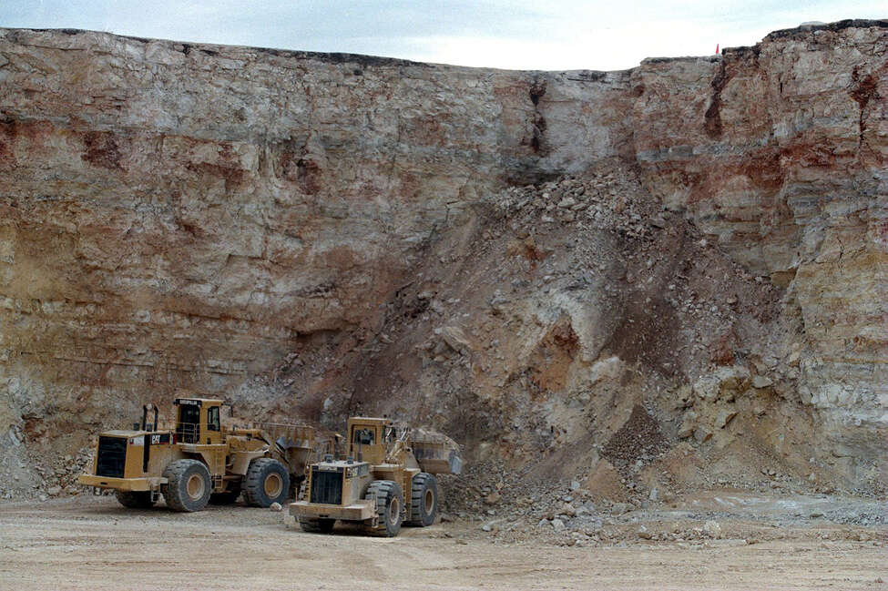 FOR BUSINESS--Heavy loaders work 24 hours a day loading limestone to be crushed. Rick Hunter/Staff