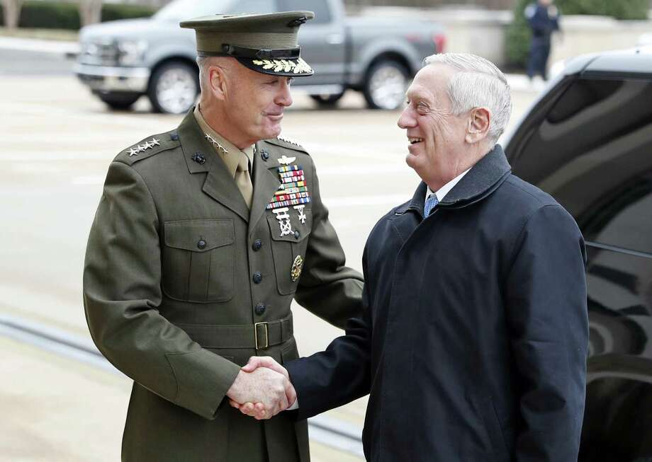 "FILE - In this Jan. 21, 2107 file photo, Joint Chiefs Chairman Gen. Joseph Dunford greets Defense Secretary Jimn Mattis at the Pentagon. A new military strategy to meet President Donald Trump's demand ""to obliterate"" the Islamic State group is likely to deepen U.S. military involvement in Syria, possibly with more ground troops, even as the current U.S. approach in Iraq appears to be working and will require fewer changes. Dunford said Feb. 23 that the strategy will take aim not just at the Islamic State but at al-Qaida and other extremist organizations in the Middle East and beyond whose goal is to attack the United States. He emphasized that it would not rest mainly on military might. (AP Photo/Alex Brandon, File) Photo: Alex Brandon, STF / Associated Press / Copyright 2017 The Associated Press. All rights reserved."
