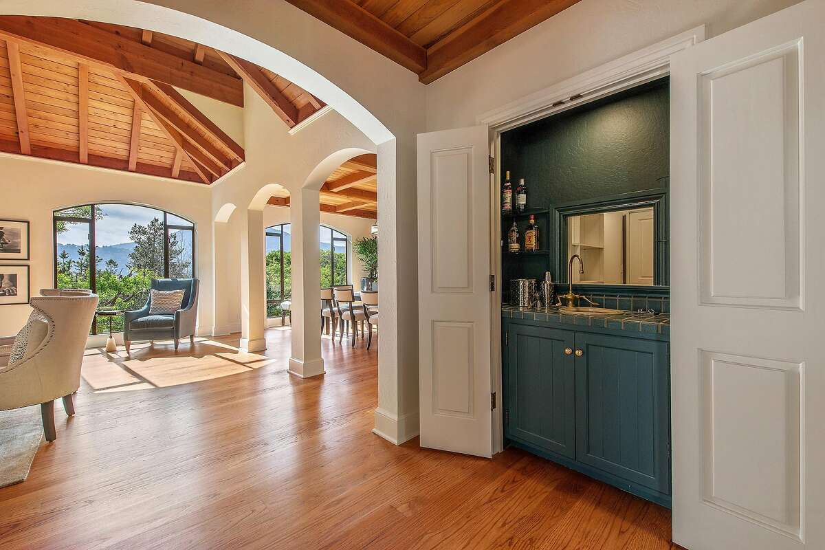 The updated interior offers a hidden wet bar, interior archways, and an open beam ceiling.