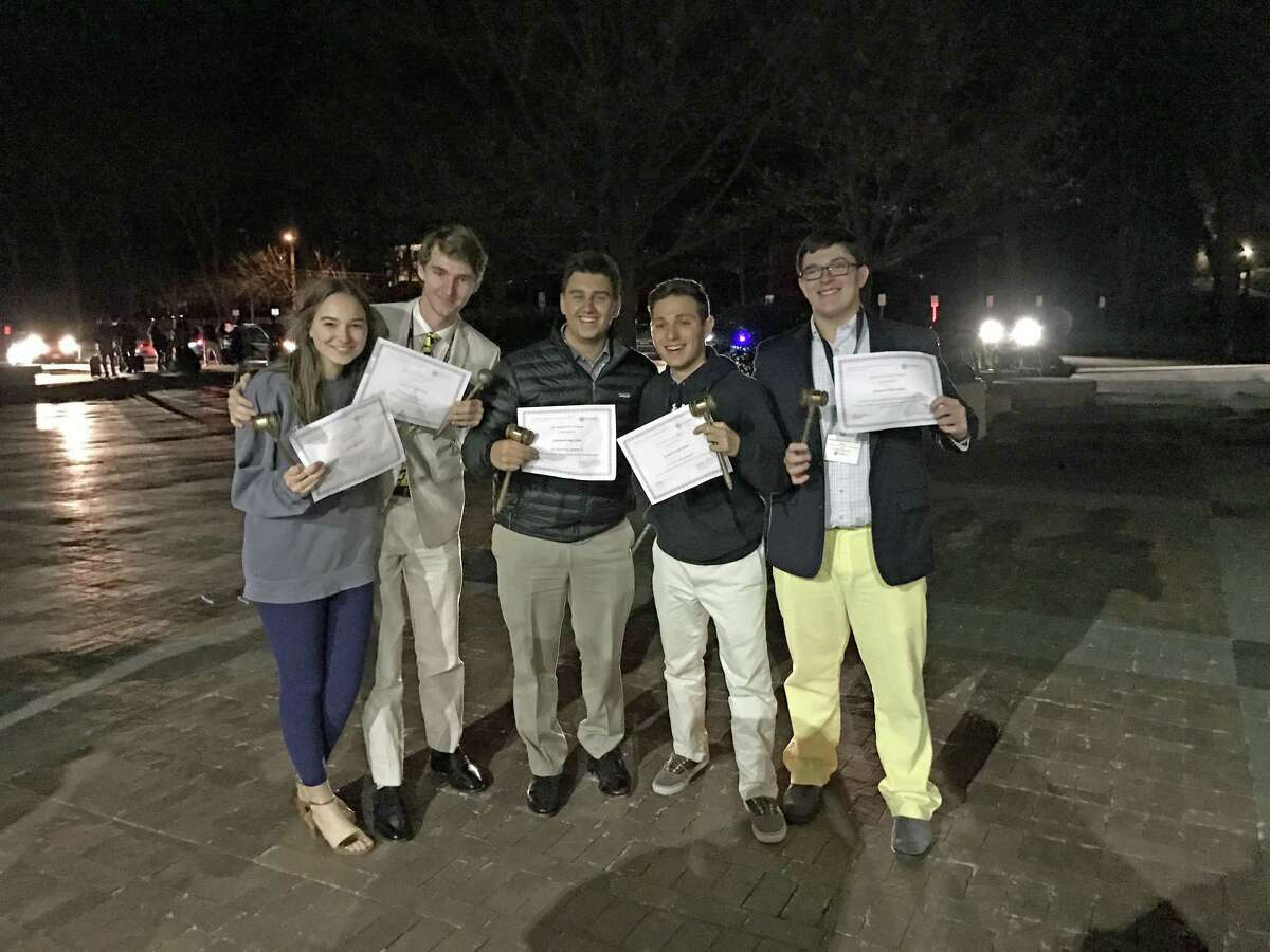 """Members of the GHS Model UN team junior Willa Doss and seniors Aaron Jaffe, Alex Schnur, Joe Magliocco and Kevin Jordan pose after collecting """"Best Delegate"""" awards at the Washington Area Model United Nations Conference in Washington D.C. from March 2 to 5, 2017."""