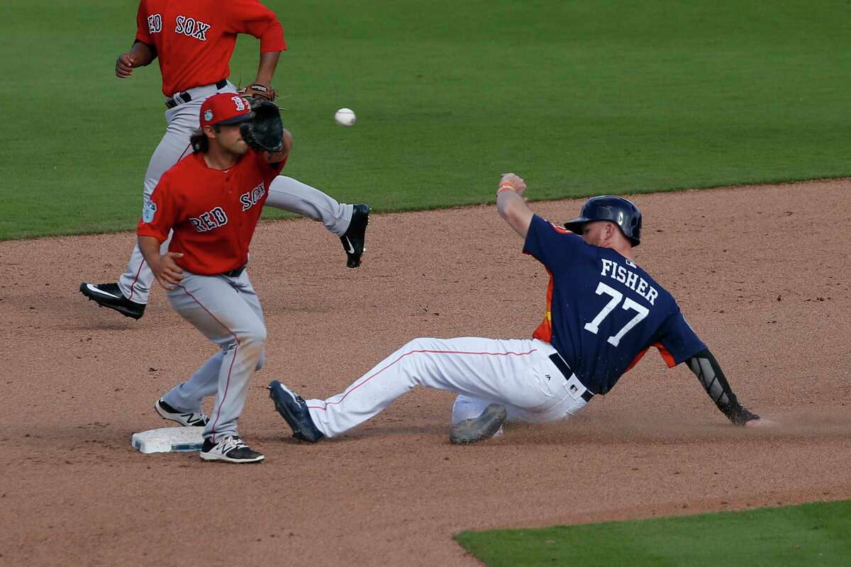 WEST PALM BEACH, FL - MARCH 6: Derek Fisher #77 of the Houston Astros steals second base under the tag by Allen Craig #5 of the Boston Red Sox in the seventh inning during a spring training game at The Ballpark of the Palm Beaches on March 6, 2017 in West Palm Beach, Florida. The Astros and Red Sox played to a 5-5 tie.