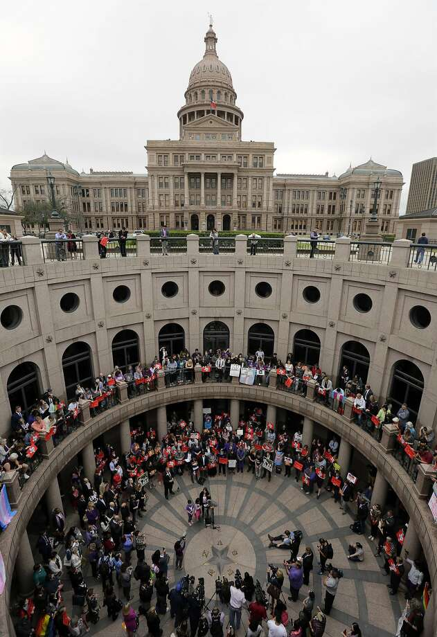 """Members of the transgender community and others who oppose Senate Bill 6 protest in the exterior rotunda at the Texas Capitol as the Senate State Affairs Committee holds hearings on the bill, Tuesday, March 7, 2017, in Austin, Texas. The transgender """"bathroom bill"""" would require people to use public bathrooms and restrooms that correspond with the sex on their birth certificate. (AP Photo/Eric Gay) Photo: Eric Gay, Associated Press"""