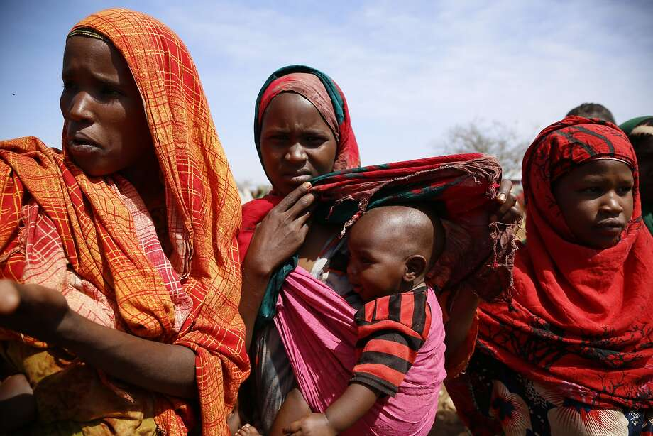 A visibly shocked U.N. chief Antonio Guterres visited a camp for people displaced by violence and drought like these women in Baidoa. Photo: Khaled Kazziha, Associated Press