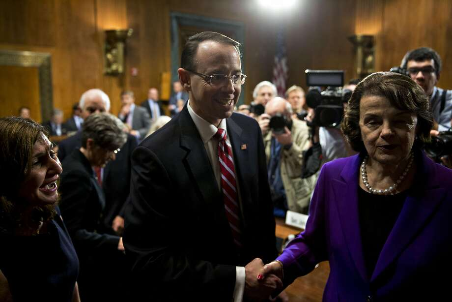 Rod Rosenstein shakes hands with Sen. Dianne Feinstein at his hearing. If confirmed, he would be in charge of the Russia investigation. Photo: Andrew Harrer, Bloomberg