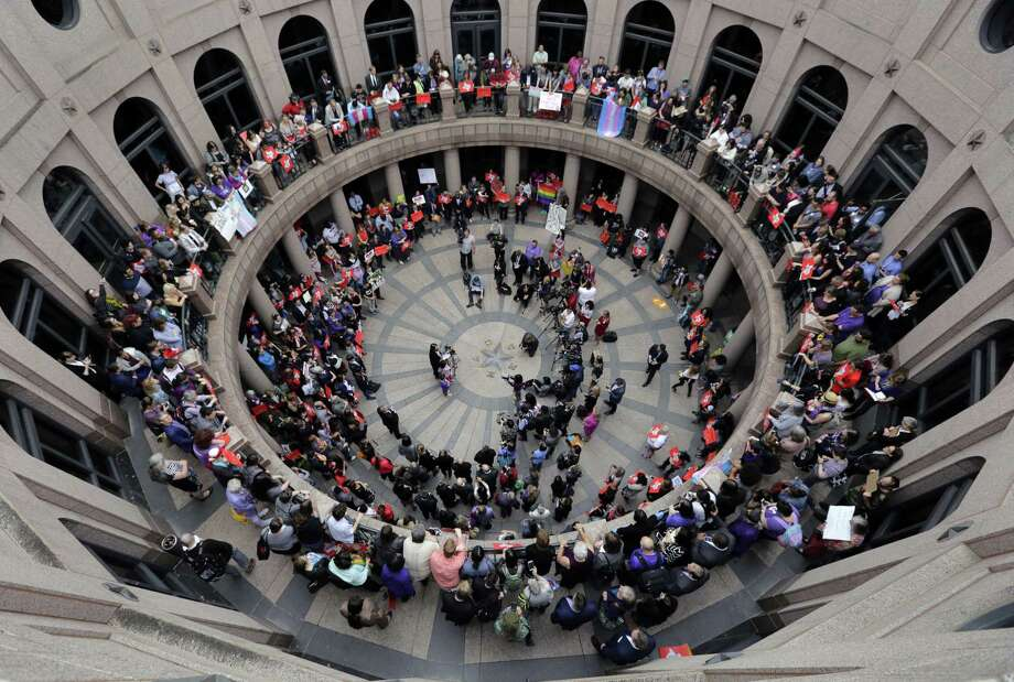Members of the transgender community and others who oppose Senate Bill 6 protest in the exterior rotunda at the Texas state Capitol March 7. The bill failed in regular session but is likely to be reprised in a special session this month. Photo: Eric Gay /Associated Press / Copyright 2017 The Associated Press. All rights reserved.