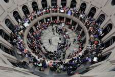 Members of the transgender community and others who oppose Senate Bill 6 protest in the exterior rotunda at the Texas state Capitol as the Senate State Affairs Committee holds hearings on the bill on March 7. The bill failed to get approved in both houses but is among the bad legislation that will get a second chance in a special session that begins on July 18.