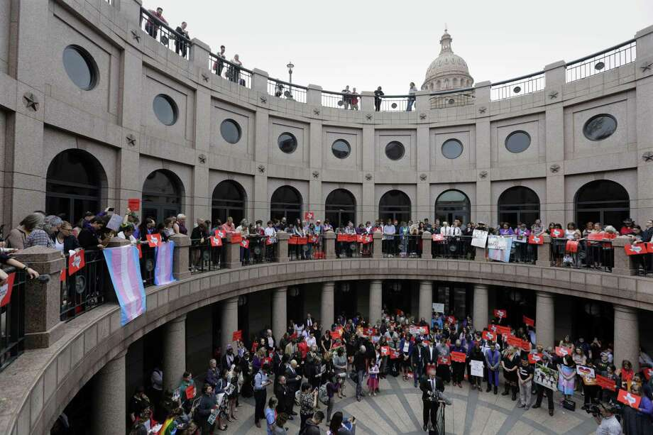 "Members of the transgender community and others who oppose Senate Bill 6 protest in the exterior rotunda at the Texas Capitol as the Senate State Affairs Committee holds hearings on the bill, Tuesday, March 7, 2017, in Austin, Texas. The the transgender ""bathroom bill"" would require people to use public bathrooms and restrooms that correspond with the sex on their birth certificate. (AP Photo/Eric Gay) Photo: Eric Gay, STF / Associated Press / Copyright 2017 The Associated Press. All rights reserved."