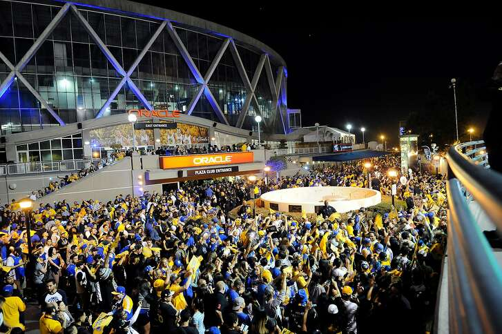Fans who attended a Game 6 Warriors Watch Party dance  outside Oracle Arena after the Golden State Warriors won the NBA championship at Oracle Arena in Oakland, CA Tuesday, June 16, 2015.