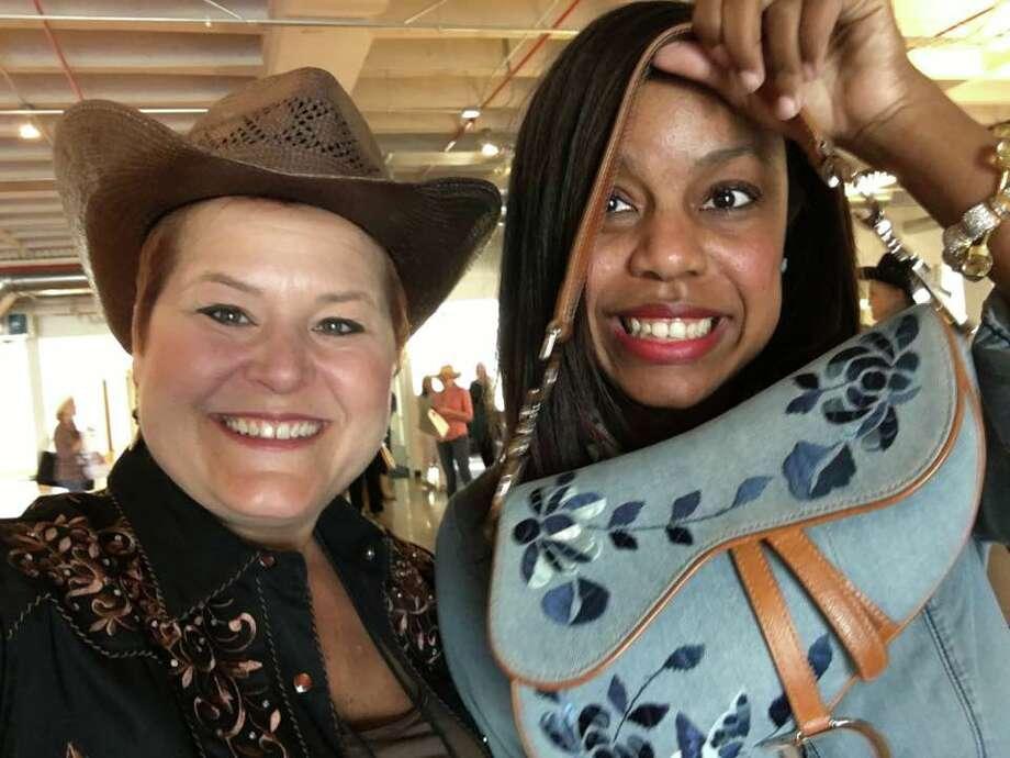 "Jill Karnicki and Amber Elliott celebrate ""Go Texan!"" day at the Houston Chronicle."