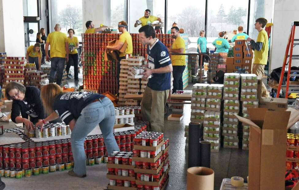 Sixteen teams consisting of more than 300 professionals from local architecture, engineering and construction firms, as well as design students, build massive structures made entirely out of canned goods at the New York State Museum to benefit The Food Pantries for the Capital District Tuesday March 7, 2017 in Albany, NY. (John Carl D'Annibale / Times Union)