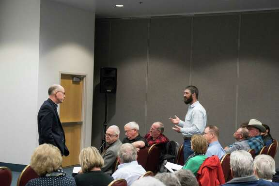 Rep. Greg Walden (left), R-Ore., attends a town hall meeting Feb. 21 in La Grande, Ore. Republicans have performed major surgery on the Obamacare replacement plan they circulated a few weeks ago, but compared with the ACA, the new plan still shifts a lot of benefits from the poor to those who earn more.