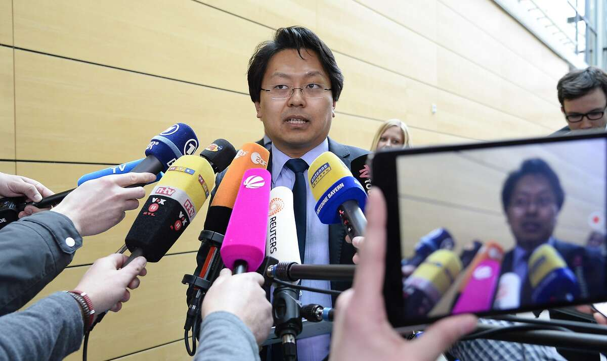 Chan-jo Jun, lawyer of Syrian refugee Anas Modamani, talks to the media in the district court in Wuerzburg, southern Germany, on March 7, 2017. The court ruled that US social media giant Facebook is not obliged to actively search out and delete defamatory posts, like those that had falsely linked the claimant, Anas Modamani, to Islamist attacks and violent crimes. / AFP PHOTO / THOMAS KIENZLETHOMAS KIENZLE/AFP/Getty Images