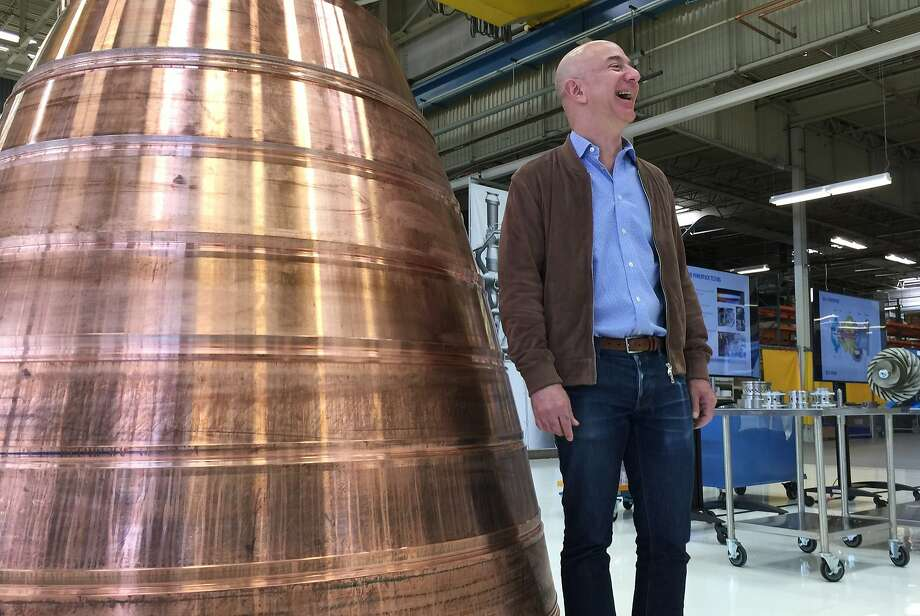 Amazon.com founder Jeff Bezos stands next to a copper exhaust nozzle to be used on a space ship engine during a media tour of Blue Origin last year. The space venture he founded has a deal with the European satellite company. Photo: Donna Blankinship, AP