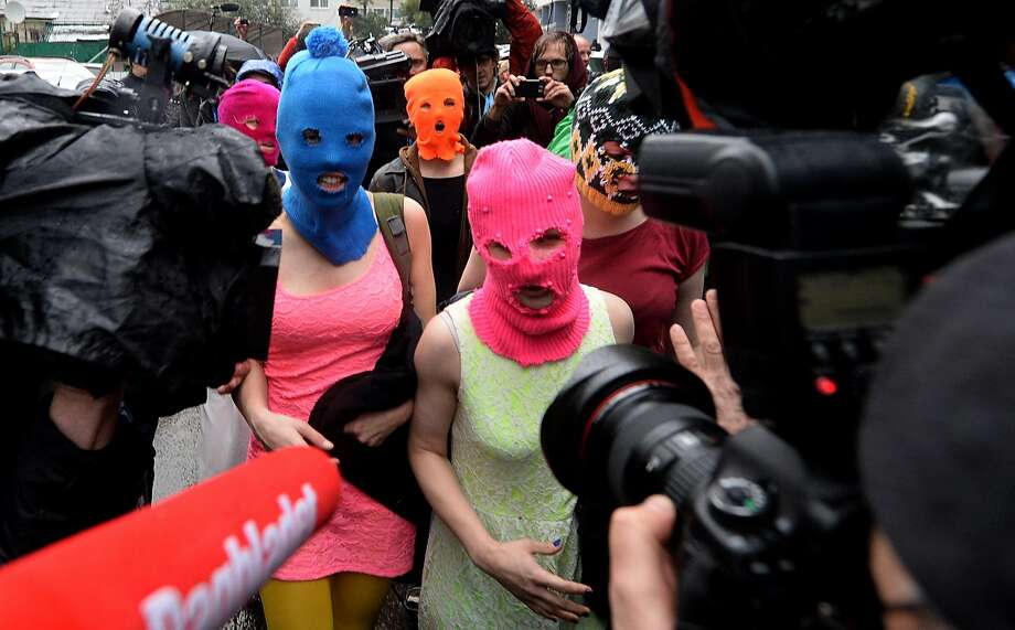 Pussy Riot's Maria Alyokhina (front) speaks after her arrest in Sochi. Photo: ANDREJ ISAKOVIC, AFP/Getty Images