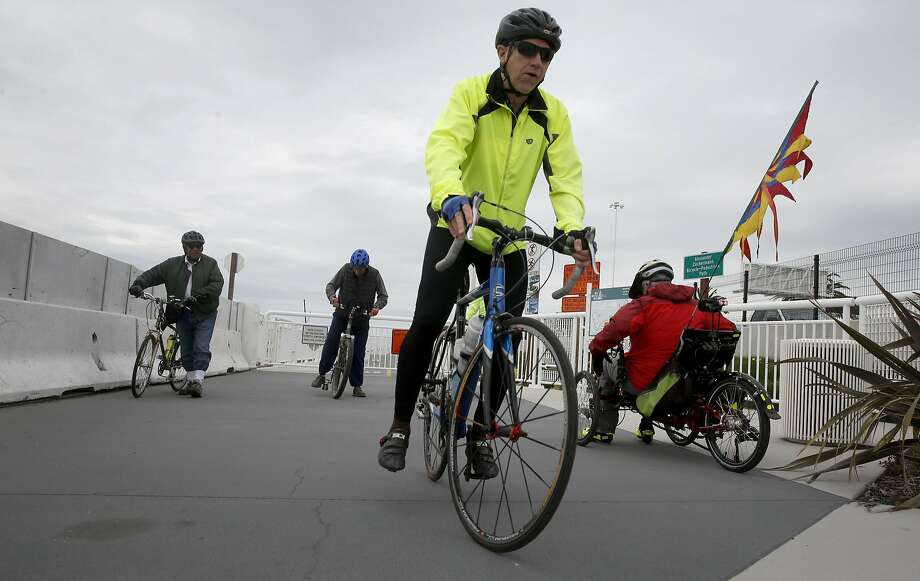 Members of the Slow Spokes bicycling group return to their starting point after going up the approach to the Bay Bridge path and reaching the barrier. Photo: Paul Chinn, The Chronicle