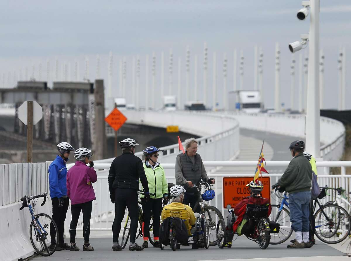Members of the Slow Spokes bicycling group rests at the end of the open portion of the Bay Bridge Trail bicycle and pedestrian path in Oakland, Calif. on Tuesday, March 7, 2017. About a two-mile section of the path, from Yerba Buena Island to the foot of the new eastern span, remains closed on weekdays while construction crews continue dismantling the old bridge and is only open during daylight hours on the weekends.