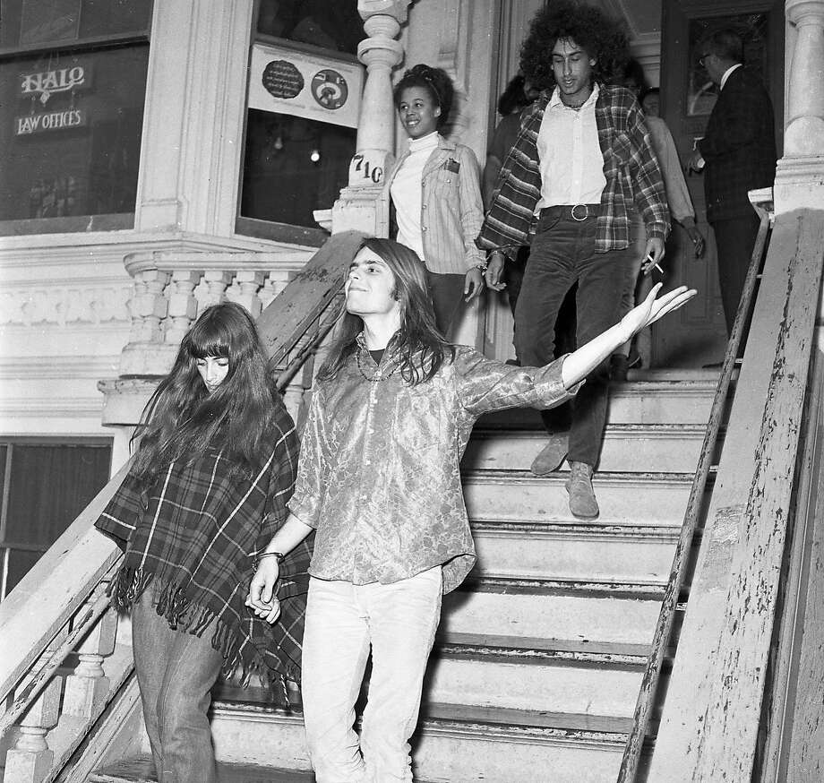 """Oct. 2, 1967: Members of the Grateful Dead and friends were busted at their 710 Ashbury home by narcotics police. Ron """"Pig Pen"""" McKernan and Bob Weir were the band members arrested. Photo: Barney Peterson, The Chronicle"""