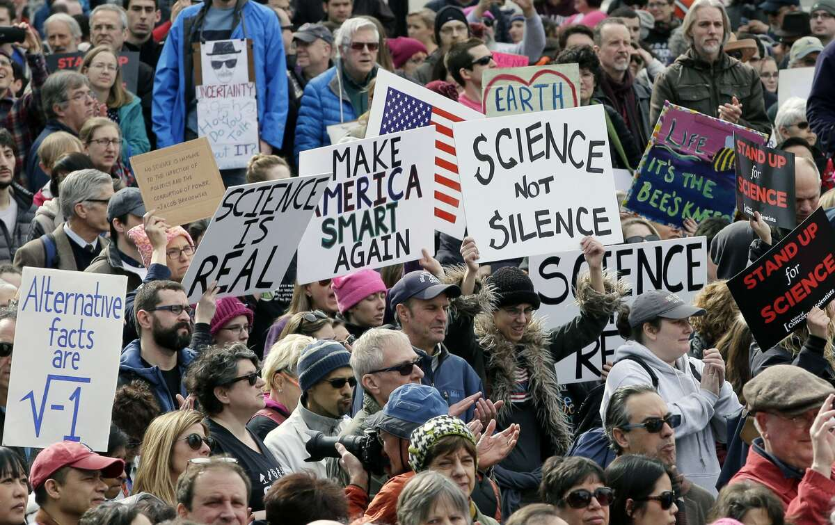 Members of the scientific community, environmental advocates, and supporters demonstrate Sunday, Feb. 19, 2017, in Boston, to call attention to what they say are the increasing threats to science and scientific research under the administration of President Donald Trump.