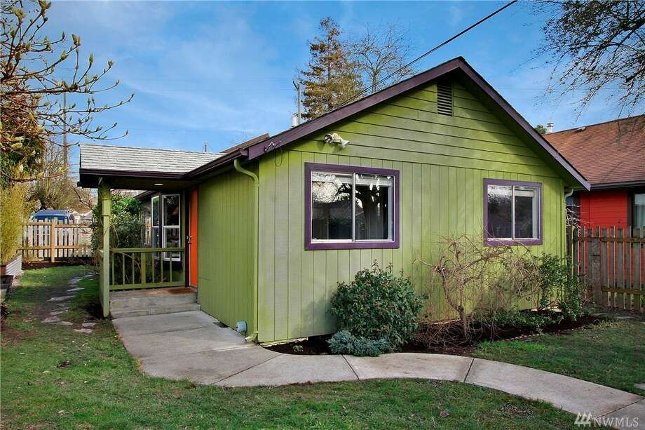 This charming Rainier Beach house features a brightly lit open floor plan, with skylights and windows that make this three-bedroom dwelling feel airy. The house features a patio to relax on, as well as stainless steel appliances, new interior paint and an updated kitchen. 