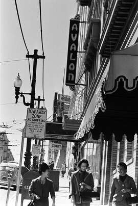 SAN FRANCISCO - 1967:  Locals walk past the Avalon Ballroom, one of the rock music palaces in San Francisco, California, in the early summer, 1967.  (Photo by Michael Ochs Archives/Getty Images)
