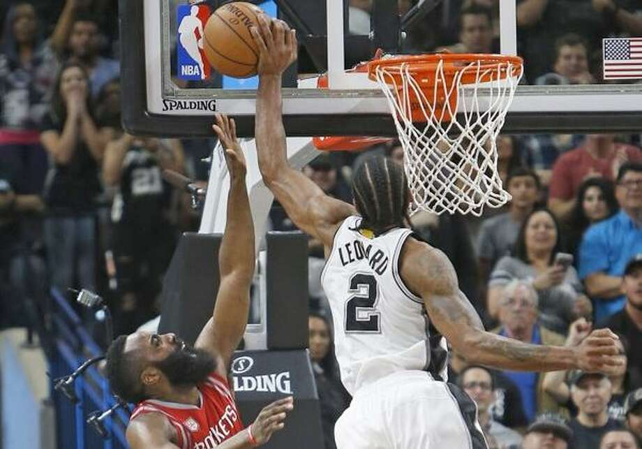 The Spurs' Kawhi Leonard blocks the shot attempt of the Rockets' James Harden in the waning moments of the March 6, 2017, game at the AT&T Center. Photo: Getty Images