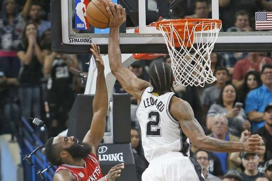 The Spurs' Kawhi Leonard blocks the shot attempt of the Rockets' James Harden in the waning moments of the March 6, 2017, game at the AT&T Center.
