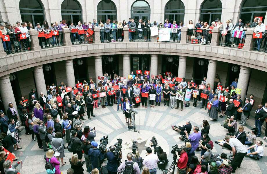 Danielle Skidmore speaks to those gathered in the outdoor area of the Capitol extension in opposition to legislation as the Senate State Affairs committee holds a hearing on the controversial bathroom bill,bill SB6, in the Capitol on March 7, 2017. Photo: Tom Reel, San Antonio Express-News / 2017 SAN ANTONIO EXPRESS-NEWS