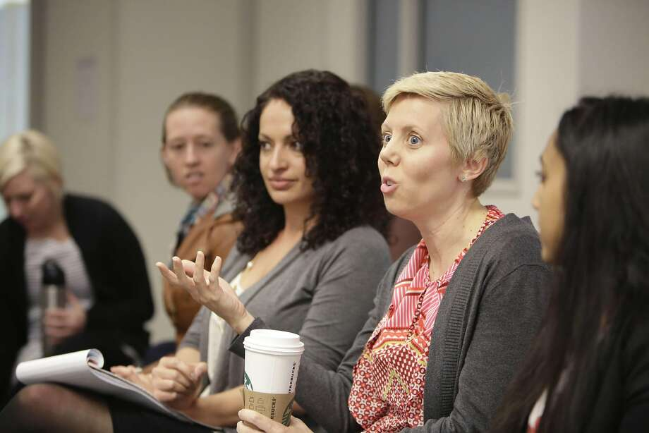 "Katie Burke, a family law attorney at the Wald Law Group, takes part in a planning session for ""A Day Without a Woman."" Photo: Lea Suzuki, The Chronicle"