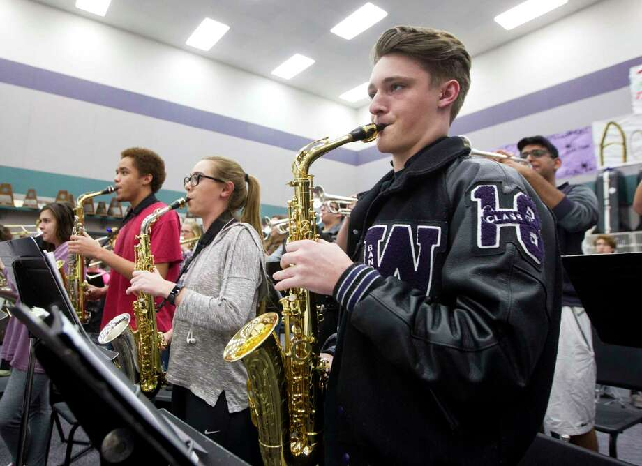 Junior saxophonist Andrew Fennell, right, performs along with the rest of the Willis High School wind ensemble during rehearsal Tuesday, March 7, 2017, in Willis. Fennell and the rest of the wind ensemble will participate in the Music for All National Festival in Indianapolis March 9-11. In addition to his performance with the ensemble, Fennell will join the school's saxophone quartet to perform a separate concert Saturday. Photo: Jason Fochtman, Staff Photographer / © 2017 Houston Chronicle