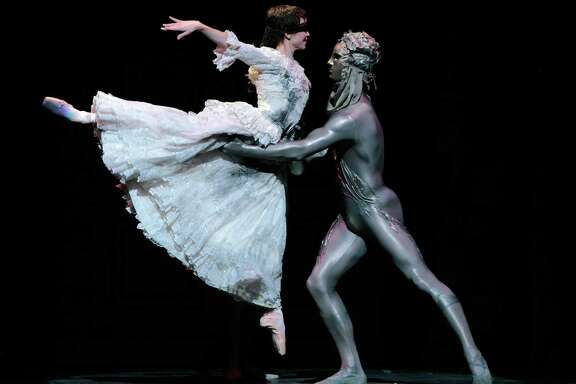 Houston Ballet's Melody Mennite and a partner in a scene from Stanton Welch's Cinderella, Feb. 23-March 4.